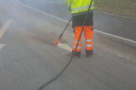 Road line removal in progress